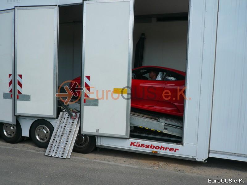 Перевозка автомобилей крытым автовозом